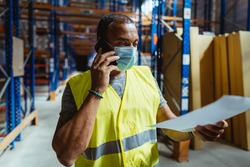 warehouse manager wearing a face mask