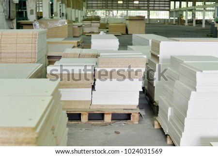 Warehouse of particle boards or chipboards materail for support the furniture manufacturers.