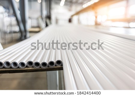 Warehouse of polypropylene pipes. Workshop with extruders for producing plastic pipes. High speed extrusion line of water suppply and gas pipe. Manufacturing facility.