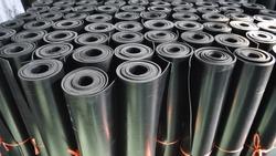 warehouse rolls of rubber. black coating rolls.