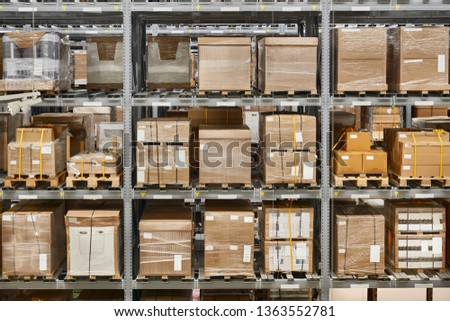 Warehouse shelves with loaded loaded up with bulk boxes #1363552781