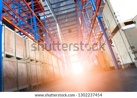 Warehouse storage, steel shelves with outside light. #1302237454