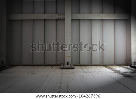 warehouse wall in dim light.