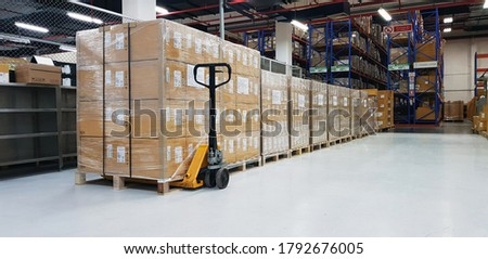 Warehouse with cardboard boxes inside on pallets racks, logistic center. Huge, large modern warehouse. Warehouse filled with cardboard boxes on shelves, boxes stand on pallets