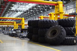 Warehouse with tires for trucks at an industrial plant for the production of cars. Automotive services. Small sharpness, possible granularity