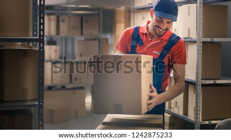 Warehouse Worker Collects Cardboard Boxes and Parcels of the Shelf and Puts them On Cart.
