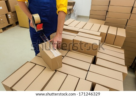 Warehouse worker packaging product for a customer