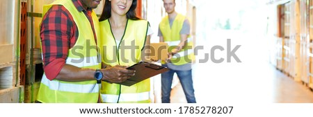 Warehouse worker team preparing cardboard boxes for shipment in a large warehouse distribution center. checking export warehouse logistic and industry background shelves with goods.logistic business Stock photo ©