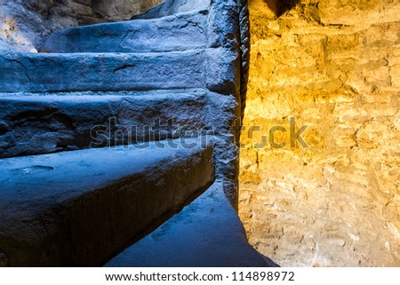 Warm and cold light in stone staircase