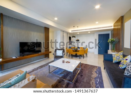 Warm and comfortable modern design living room with dining table, sofa and fur carpet, potted plant and marble floor, contemporary architecture interior design. #1491367637