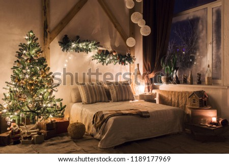 warm and cozy evening in living room. Sofa bed In christmas Interior. concept the new year and holidays.