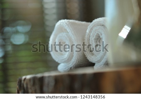 Warm atmosphere in spa resort, Close up of spa essentials and towels on wooden tray in bathroom, essential oil. Spa products set conception. #1243148356