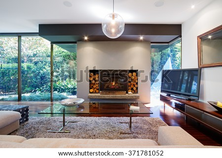 Warm australian living room with fireplace in contemporary Luxury fireplaces luxury homes
