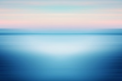 Warm autumn day sunset at sea shore, vibrant tones colorful landscape. Beautiful minimalist abstract background artwork. Deformed landscape photography with blurred linear motion effect