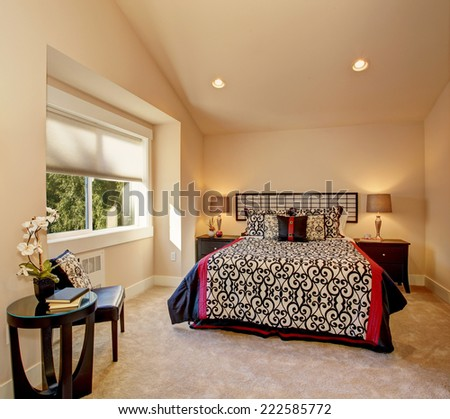 warm bedroom with high vaulted...