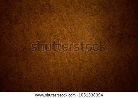 Warm, brown texture for design creativity. Dark, brown background.