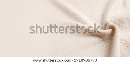 Warm cashmere fabric as background, closeup view with space for text. Banner design ストックフォト ©