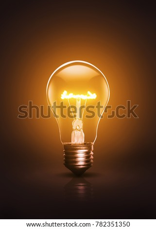 Warm colored and active bulb on a dark background.