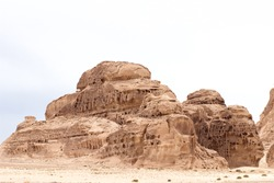 Warm colors background. White Canyon in Sinai. Yellow sandstone textured carved mountain, bright sky. Egyptian desert landscape.