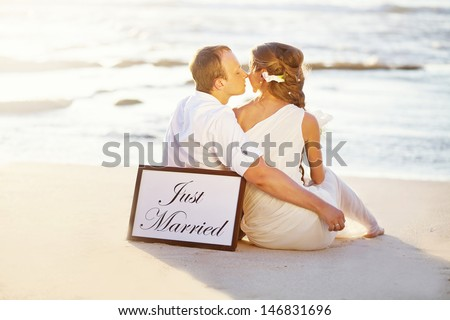 warm colors of evening wedding on the beach