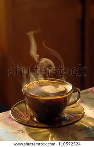 warm cup of coffee with smoke