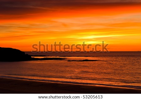 Warm evening glow on beach with copy space.