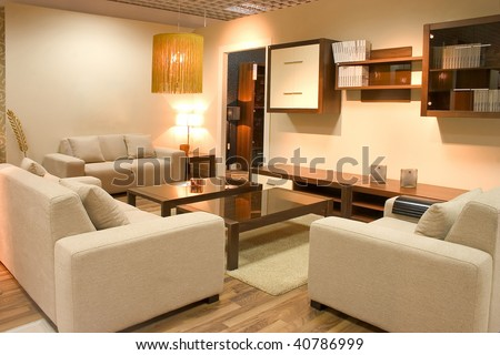 Warm interior of cosy living room with white sofas and tables.