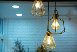 Warm light bulbs in coffee shops,Get and idea concept with copy space.