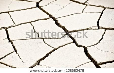 Warm light concrete background, rock pieces texture, patterned crack concrete, cracked concrete texture closeup background, focus  to the centre