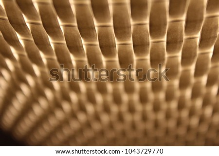 warm light shining through woven texture. overlapping yellow and white layers. glowing.  #1043729770