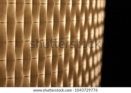 warm light shining through woven texture. overlapping yellow and white layers. glowing.  #1043729776