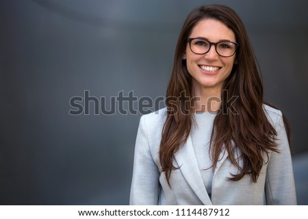 Warm likable commercial friendly portrait of a smart beautiful natural woman, business executive person #1114487912