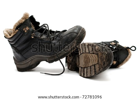 warm old dirty shoes lie on a white background