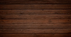 Warm orange brown weathered wood surface with long boards lined up. Wooden planks on a wall or floor with grain and texture. Dark neutral tones with contrast.