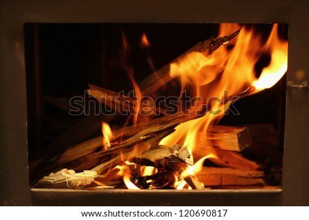 warm orange flames in the fireplace