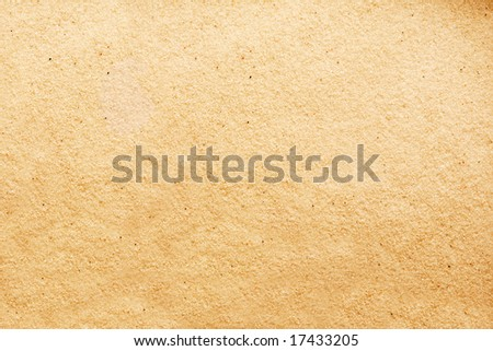 Warm soft sand background texture with fine detail
