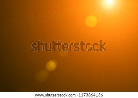 Warm sunlight is isolated on a black background with lens flare effect for overlay design or screen blending mode