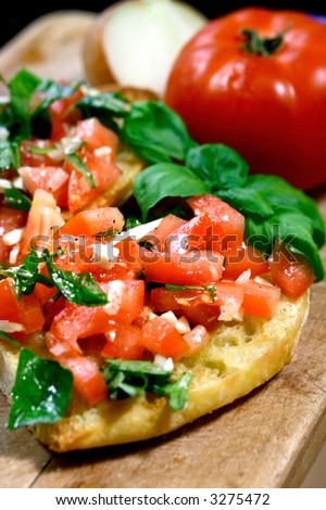 Warm toasted bruschetta with topping of fresh tomatoes, onion and fresh shredded basil leaves.