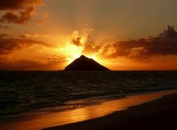 Warm tropical sunrise over an island at Lanikai Beach, Oahu, Hawaii.