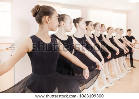 2dfb69e185f2 Free photos Young beautiful ballerina warming up in ballet class ...