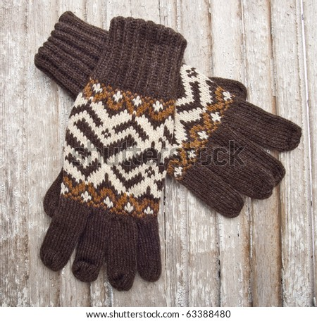Warm Winter Gloves Holiday Concept on Vintage Wood.