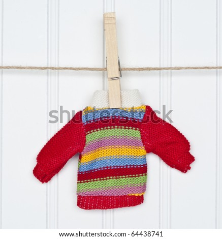 Warm Winter Striped Sweater on a Clothesline.  Holiday Concept.