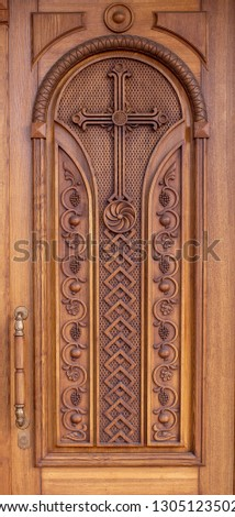 warm wooden door with crosses