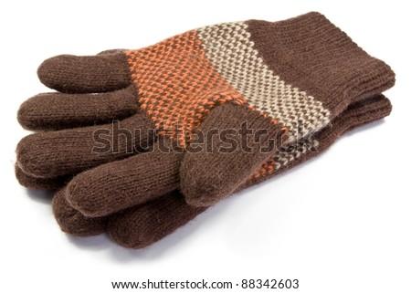 warm  woolen knitted gloves  over white background