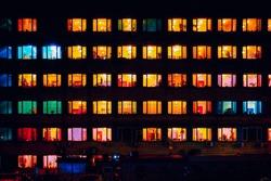 warm yellow red blue light inside windows at night