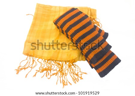 Warm yellow scarf and striped orange-black leggings over white background.