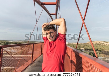 Warming and stretching man in bridge before and after running