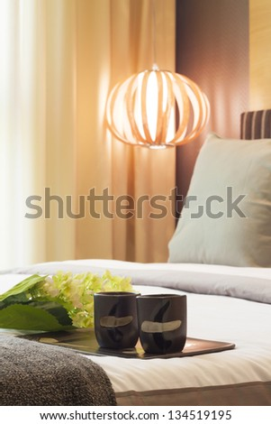 warming bedroom decorated with tea cups.