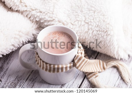 Warming drink - cup of cocoa with milk on the table