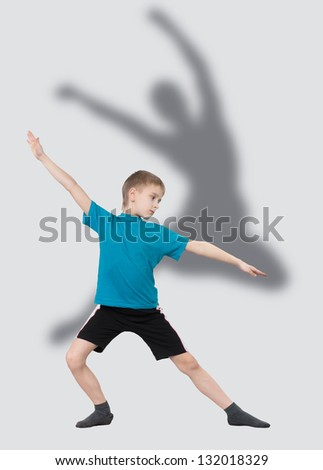 Warming up boy with dancer's silhouette behind him